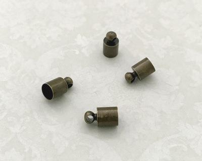 25595 Концевик для шнура 9х5мм, вн.диам. 4,5мм, уп.4шт, цв.бронза