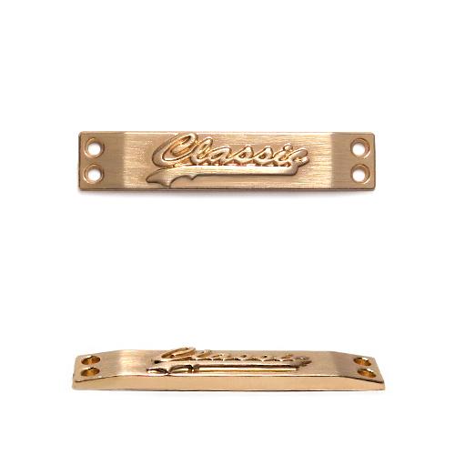 ГХН1091 Украшение Лого Classiс 32*6,5мм (нашивка), тёртое золото