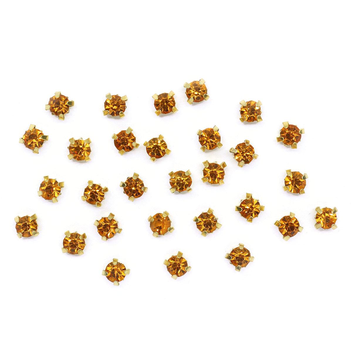 ЗЦ013НН44 Хрустальные стразы в цапах круглые (золото) медовый 4*4мм, 29-30шт/упак Астра